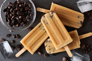 Coffee and chocolate chip ice pops, overhead view on slate